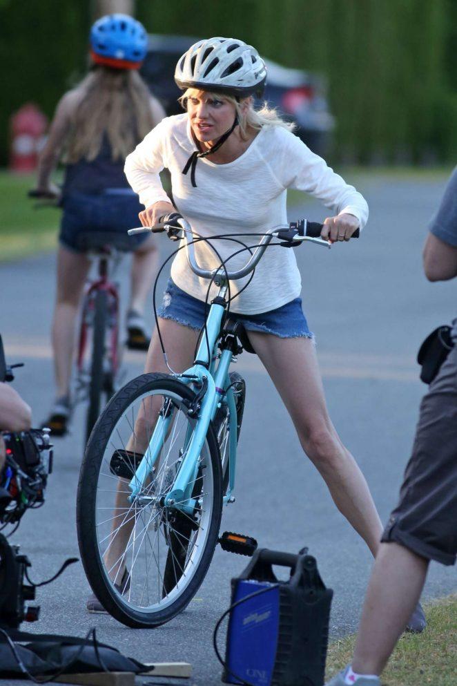 Anna Faris rides a bike for a scene in Overboard -28
