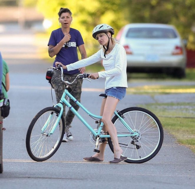Anna Faris rides a bike for a scene in Overboard -29