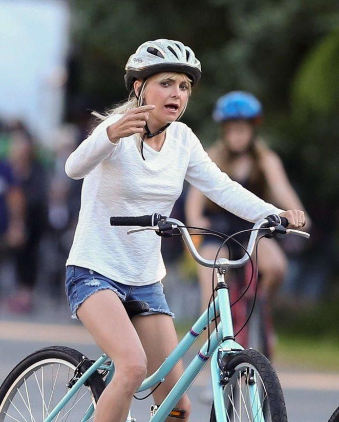 Anna Faris rides a bike for a scene in Overboard -34