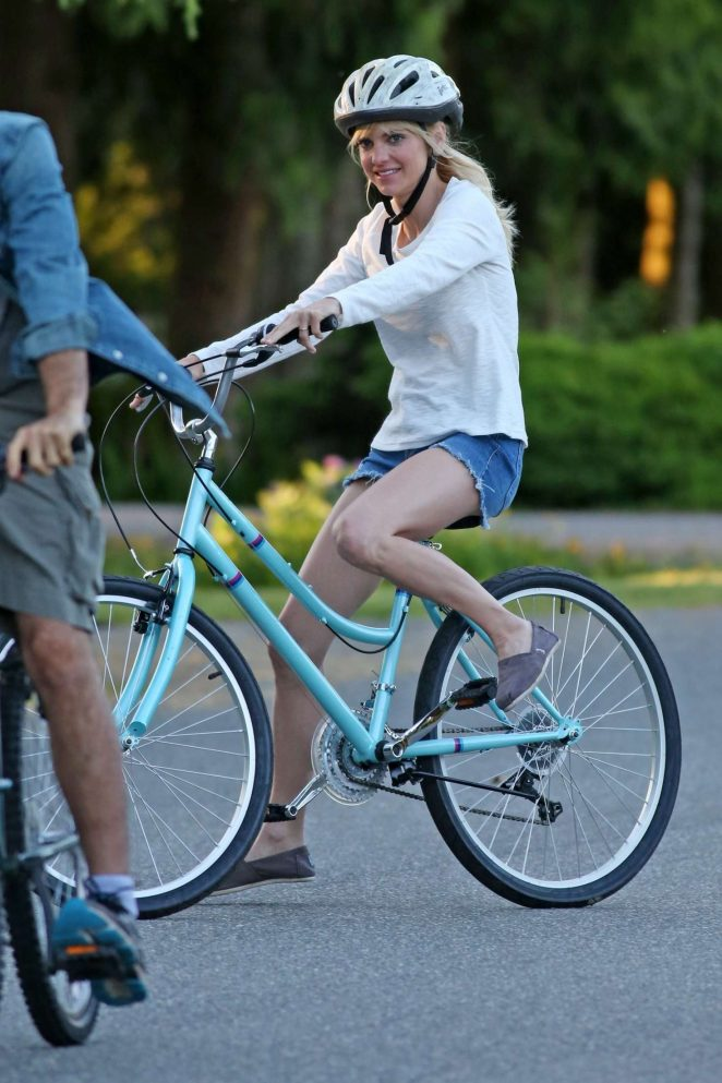 Anna Faris rides a bike for a scene in Overboard -36