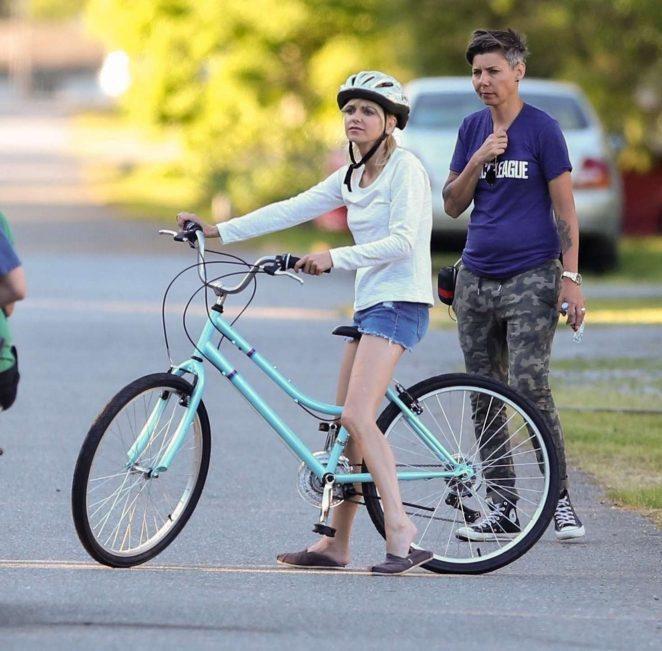 Anna Faris rides a bike for a scene in Overboard -38