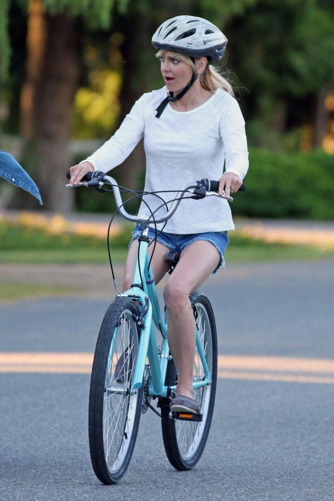 Anna Faris rides a bike for a scene in Overboard -39