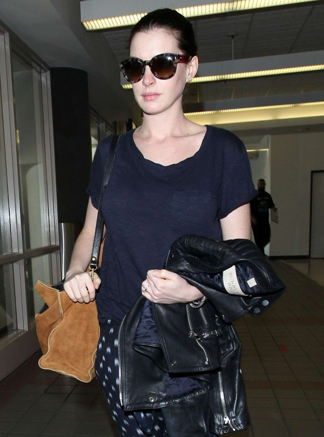 Anne Hathaway - Arriving at LAX in Los Angeles
