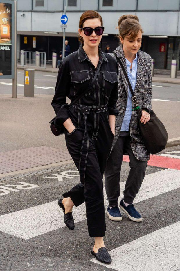 Anne Hathaway at Heathrow Airport -09