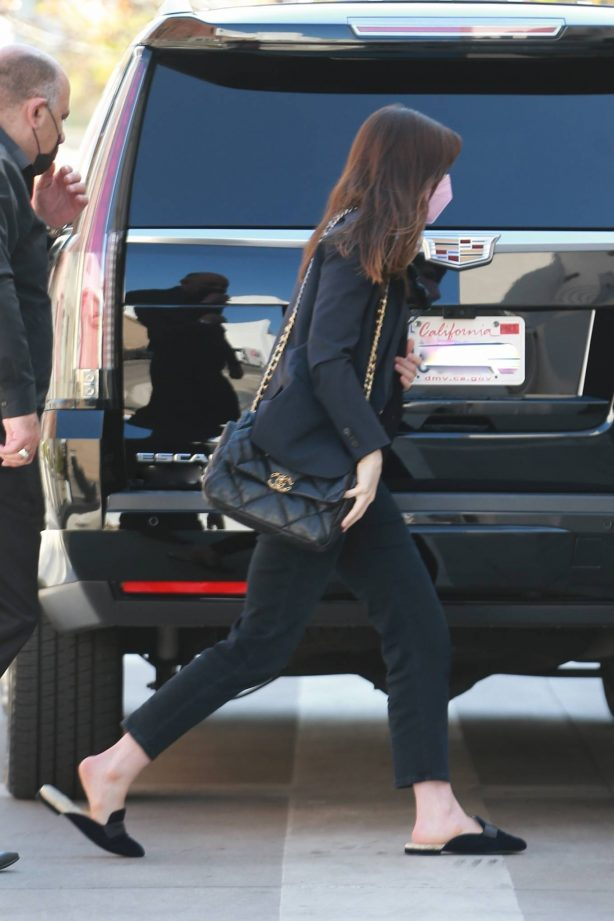 Anne Hathaway - Dressed in all black ahead of a business meeting in Los Angeles