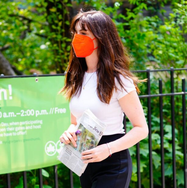 Anne Hathaway - holding a New York Times newspaper in New York City