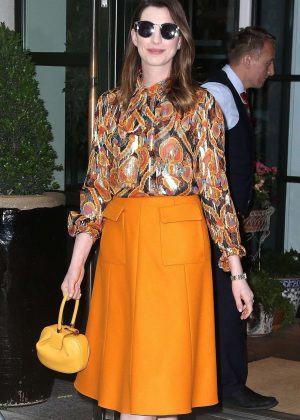Anne Hathaway in a Bright Orange Skirt - Leaving her hotel in New York