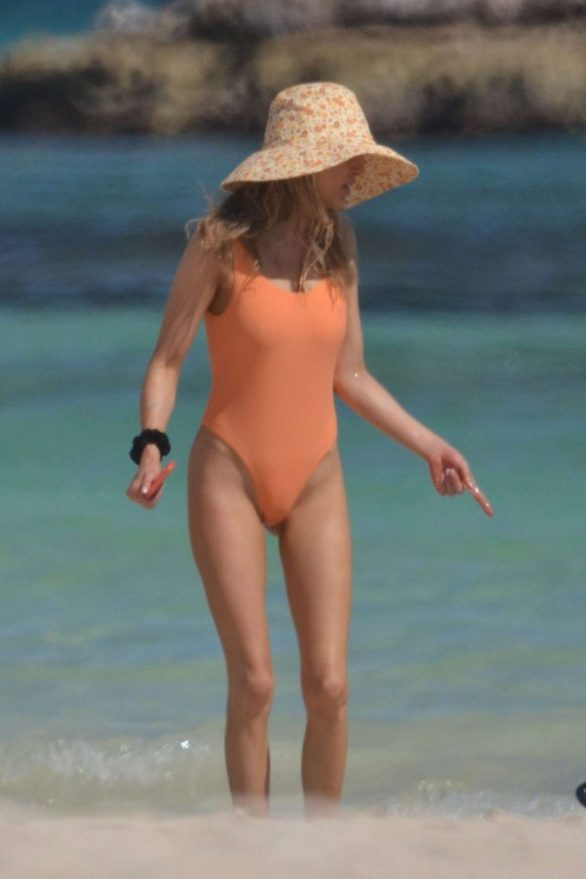 Anne Winters in Orange Swimsuit on the beach in Tulum