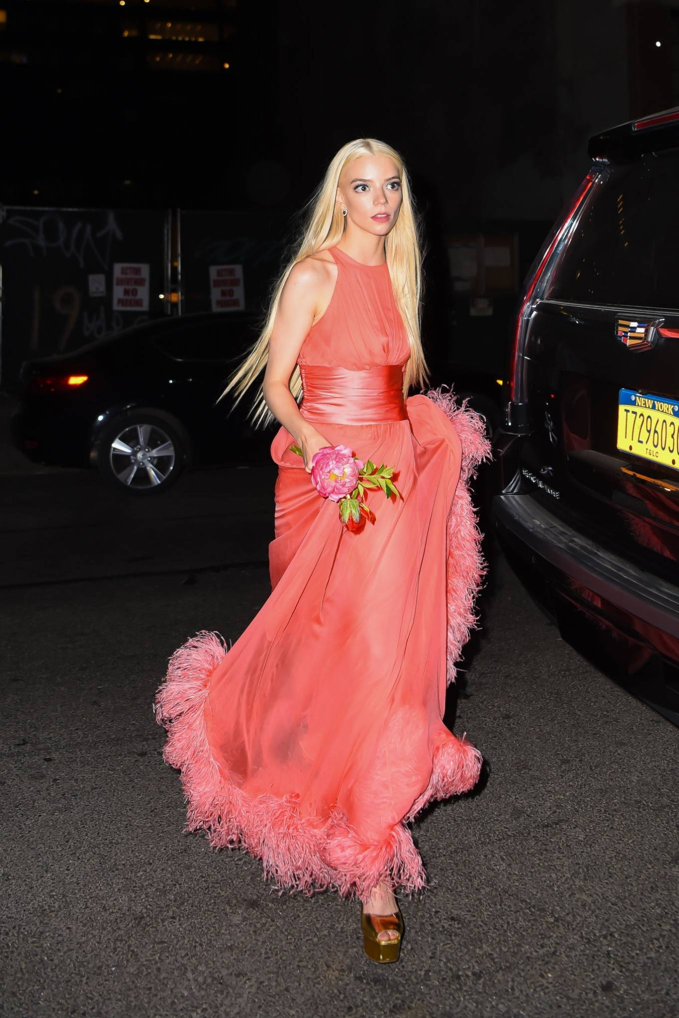 Anya Taylor-Joy - In orange dress leaving the Rockefeller Center after hosting SNL in New York