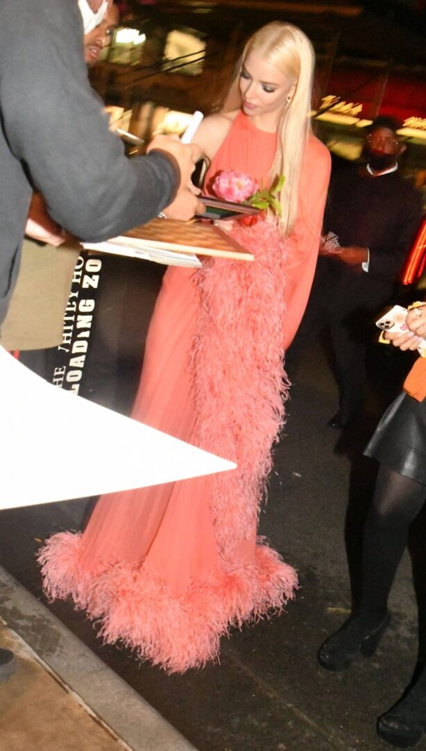 Anya Taylor-Joy - Is seen in a coral gown after her SNL debut in New York
