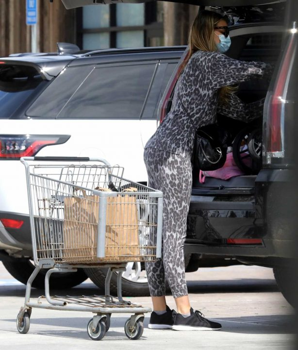 April Love Geary - In leopard print shopping candids