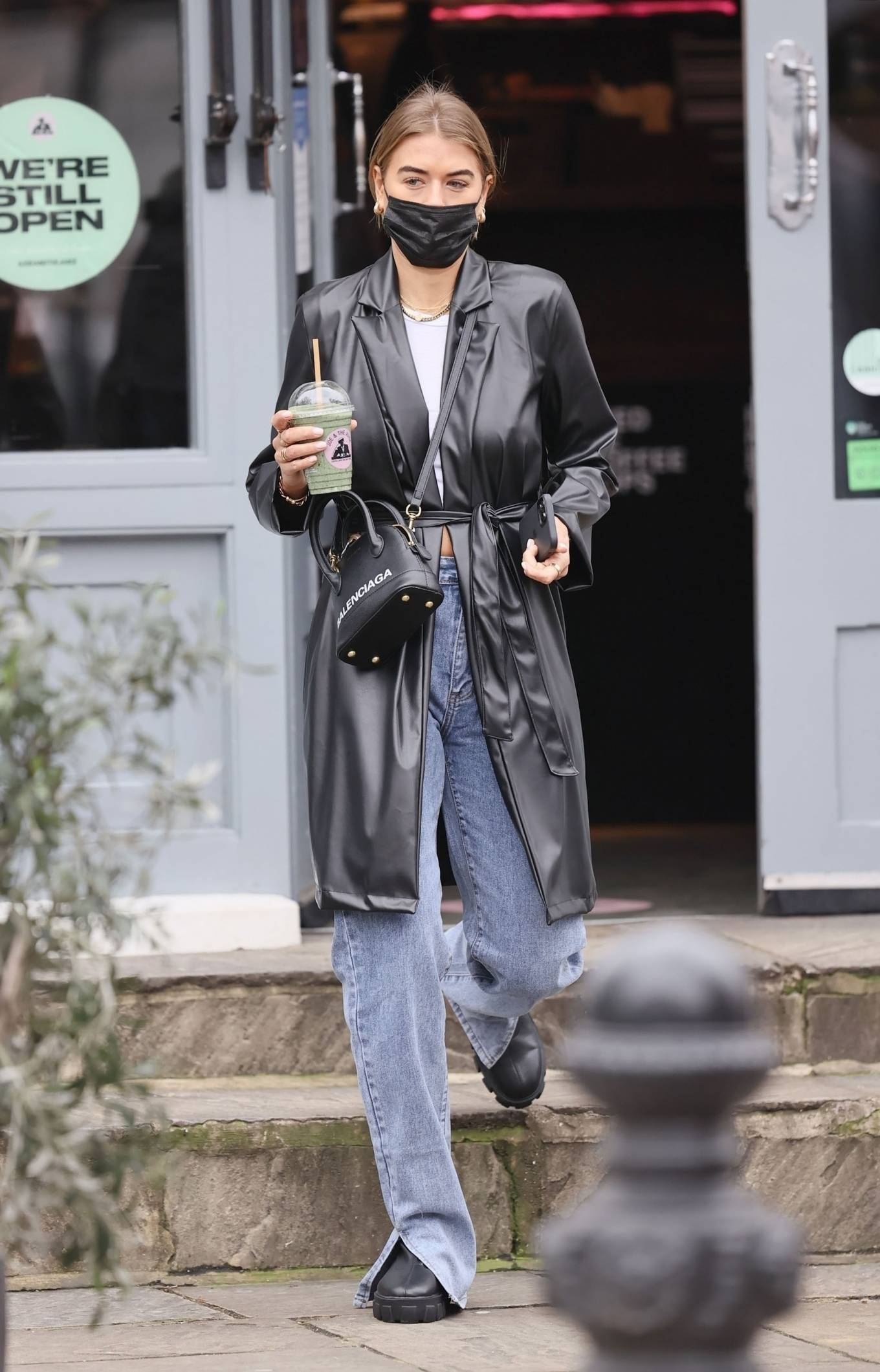Arabella Chi - Wearing her fashionable black Pretty Little Thing coat on the Kings Road in London