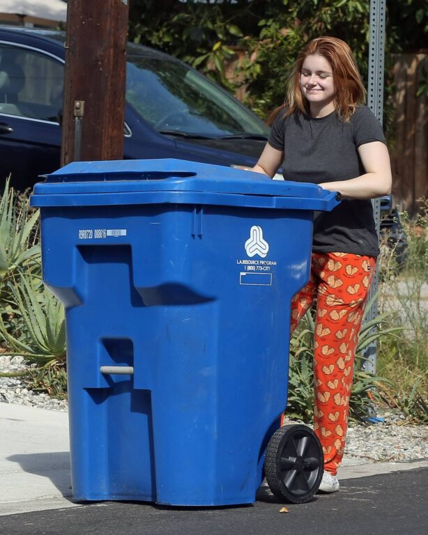 Ariel Winter - Putting out her recycled trash can in Los Angeles