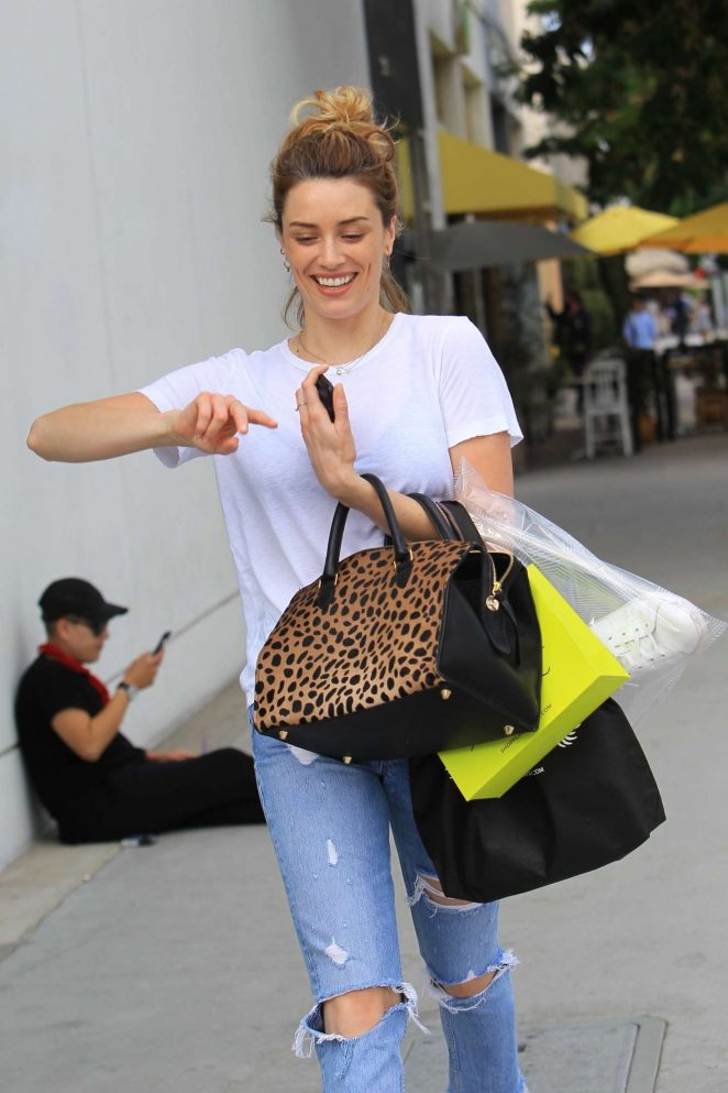 Arielle Vandenberg in jeans shopping in Beverly Hills
