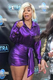 Ashanti in Purple Dress at EXTRA in Universal City