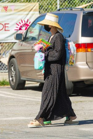 Ashlee Simpson - Wearing a straw hat and long dress in Los Angeles