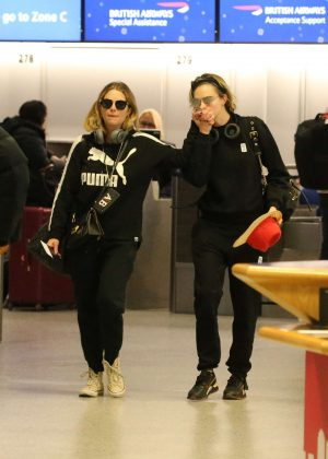 Ashley Benson and Cara Delevingne - Arrives at Gatwick Airport in England