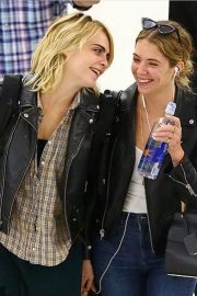 Ashley Benson and Cara Delevingne - Arrives at JFK Airport in New York City