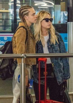 Ashley Benson and Cara Delevingne at Heathrow Airport in London