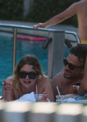 Ashley Benson on the pool in Miami