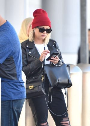 Ashley Benson - Waiting for her car at the LAX airport in Los Angeles