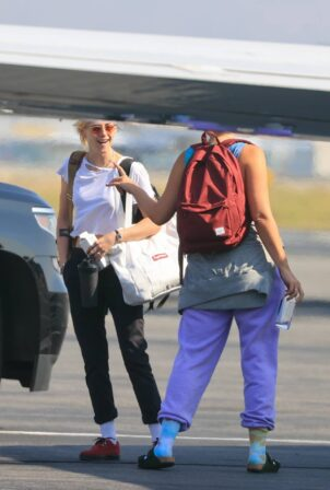 Ashley Benson - With Kristen Stewart boarding a private jet ahead of NYFW in Van Nuys