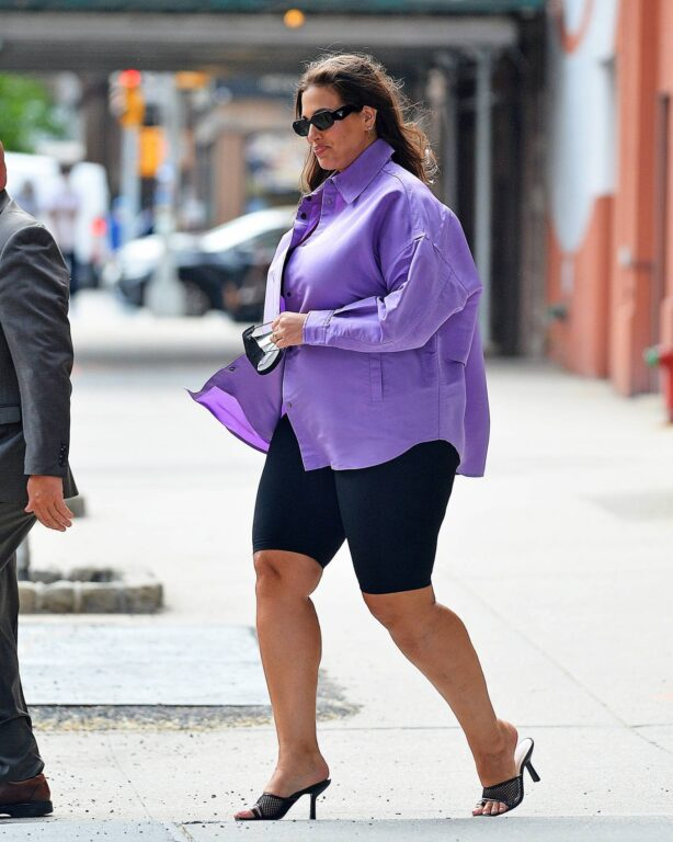 Ashley Graham - out in a purple button-up and legging shorts in New York