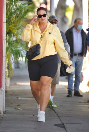 Ashley Graham - Out in bike shorts and a yellow windbreaker in Santa Monica
