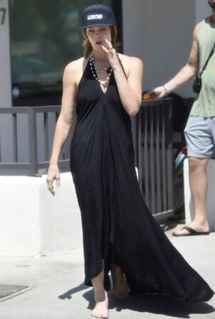 Ashley Greene - Walks barefoot on the beach with her husband Paul Khoury