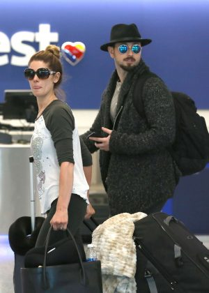Ashley Greene with her fiancee Paul Khoury at LAX Airport in LA