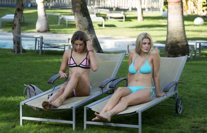 Ashley James and Olivia Cox in Bikini at a pool in Marbella