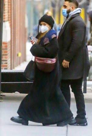Ashley Olsen - Out in a maxi black coat at her office building in Tribeca