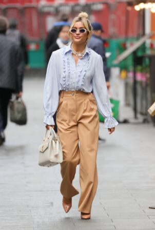 Ashley Roberts - In a blue blouse and beige trousers at Heart radio in London