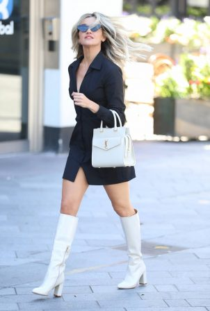 Ashley Roberts - In black mini dress and white boots in London