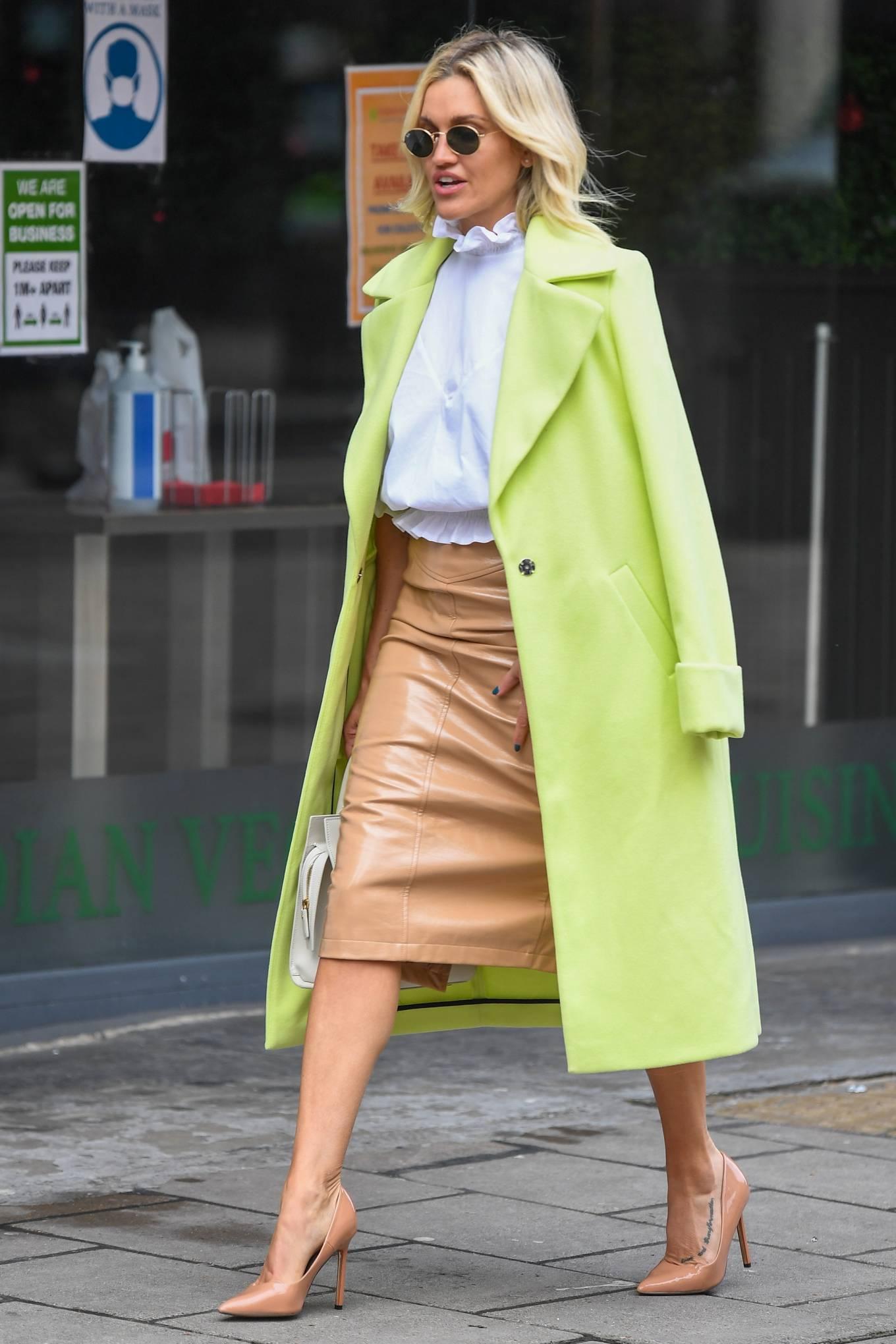 Ashley Roberts - In neon green coat leaving Global Studios in London