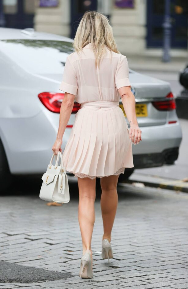 Ashley Roberts - In pleated pink dress at Heart radio in London