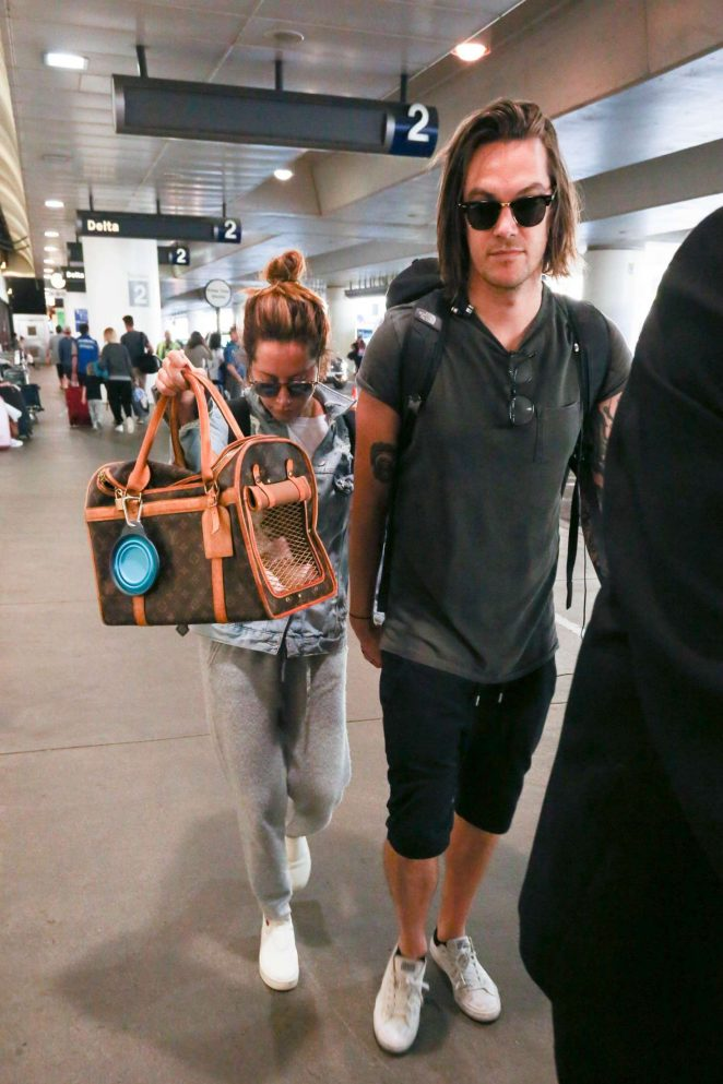 Ashley Tisdale and Christopher French at LAX Airport in LA