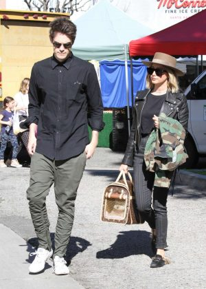 Ashley Tisdale and Christopher French with their puppy at Farmer's Market in LA