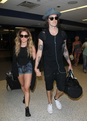 Ashley Tisdale and husband Christopher French at LAX Airport in LA