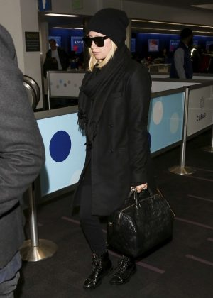 Ashley Tisdale - Arrives at LAX airport in Los Angeles