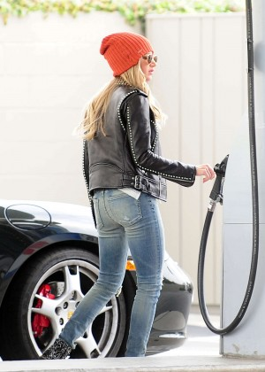 Ashley Tisdale in Jeans Pumping gas in Toluca Lake