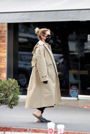 Ashley Tisdale - Wears a trench coat in Los Feliz