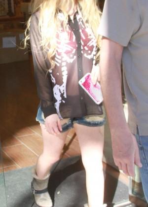 Avril Lavigne in shorts out in LA