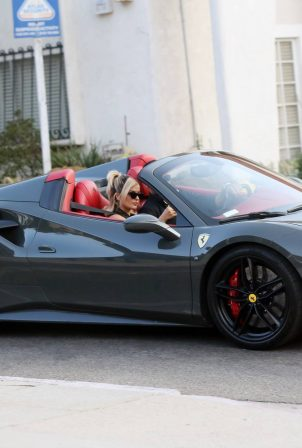 Bebe Rexha - Gets a New Ferrari Delivered to Her Home in Los Angeles