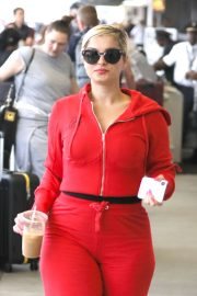Bebe Rexha in Red - Arrives at LAX International Airport in LA