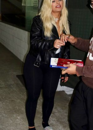 Bebe Rexha signs autographs for fans in Sydney