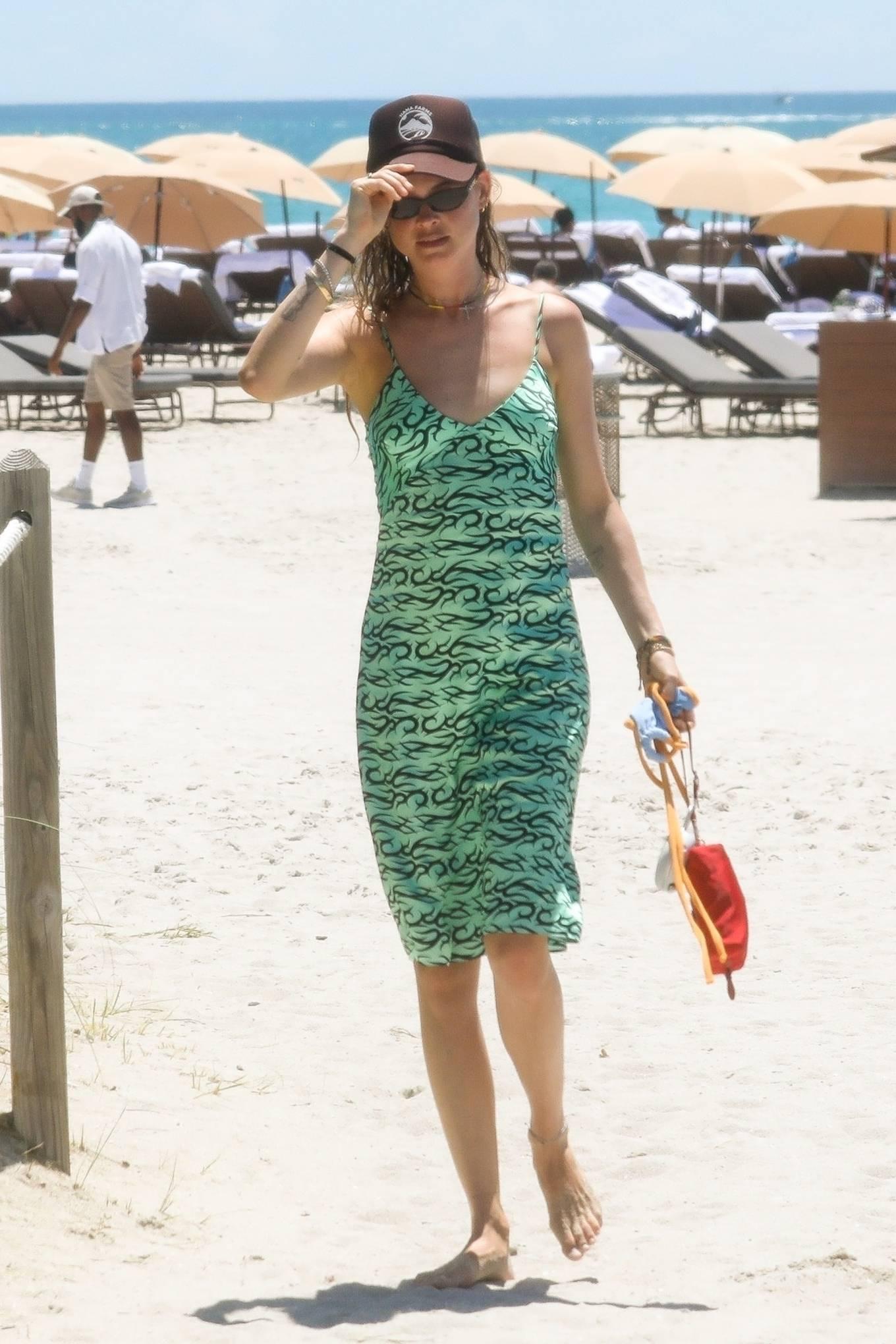 Behati Prinsloo -In a green dress in Miami Beach