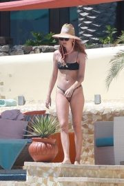 Behati Prinsloo in Bikini on the pool in Cabo San Lucas