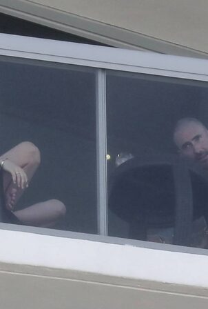 Behati Prinsloo - Seen Adam Levine outside their hotel room while vacationing in Miami Beach