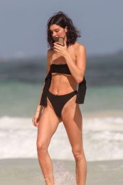 Bella Banos in Black Bikini at a beach in Tulum